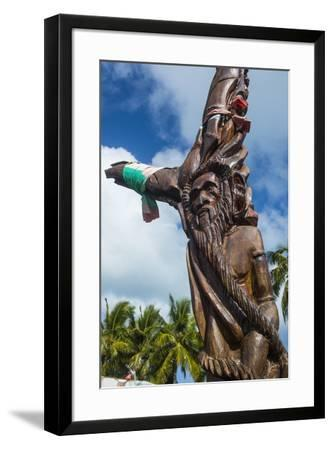 Wooden carvings on the Monument des Dix-Neuf (Monument of 19), Ouvea, Loyalty Islands, New Caledoni-Michael Runkel-Framed Photographic Print