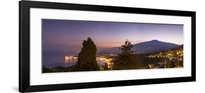 Panoramic view of Mount Etna and Giardini Naxos at dusk from Taormina, Sicily, Italy, Mediterranean-John Miller-Framed Photographic Print