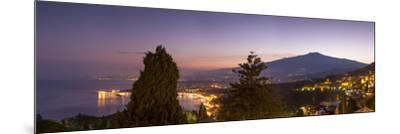 Panoramic view of Mount Etna and Giardini Naxos at dusk from Taormina, Sicily, Italy, Mediterranean-John Miller-Mounted Photographic Print