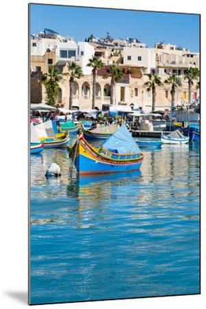Traditional brightly painted fishing boats in the harbour at Marsaxlokk, Malta, Mediterranean, Euro-Martin Child-Mounted Photographic Print