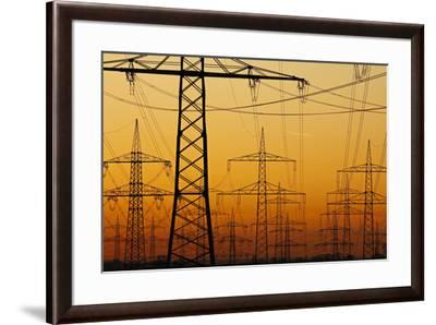 Pylons and power lines in morning light, Germany, Europe-Hans-Peter Merten-Framed Photographic Print