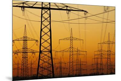 Pylons and power lines in morning light, Germany, Europe-Hans-Peter Merten-Mounted Photographic Print