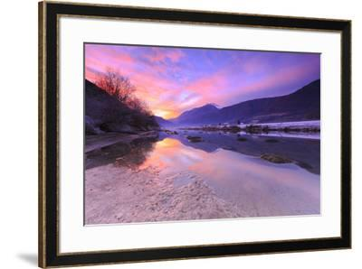 The colors of sunset are reflected in the Adda River, Valtellina, Lombardy, Italy, Europe-Francesco Bergamaschi-Framed Photographic Print