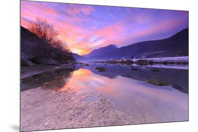The colors of sunset are reflected in the Adda River, Valtellina, Lombardy, Italy, Europe-Francesco Bergamaschi-Mounted Photographic Print