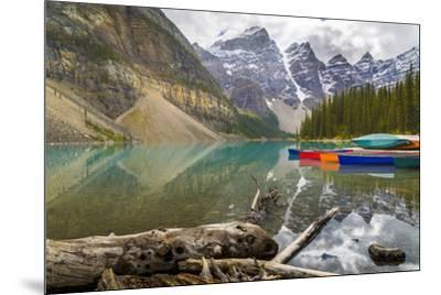 Tranquil setting of rowing boats on Moraine Lake, Banff National Park, UNESCO World Heritage Site, -Frank Fell-Mounted Photographic Print
