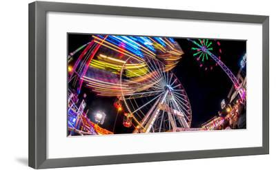 Ferris Wheel and various other funfair rides at night at Nottingham's Goose Fair, Nottingham, Notti-Frank Fell-Framed Photographic Print