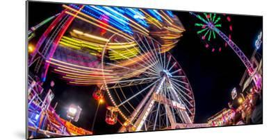 Ferris Wheel and various other funfair rides at night at Nottingham's Goose Fair, Nottingham, Notti-Frank Fell-Mounted Photographic Print