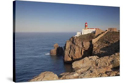 Lighthouse at sunrise, Cabo de Sao Vicente, Sagres, Algarve, Portugal, Europe-Markus Lange-Stretched Canvas Print