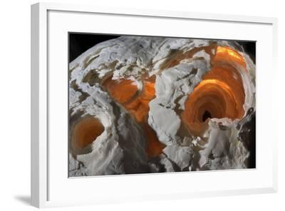 A stalagmite formation illuminated from within.-Joel Sartore-Framed Photographic Print