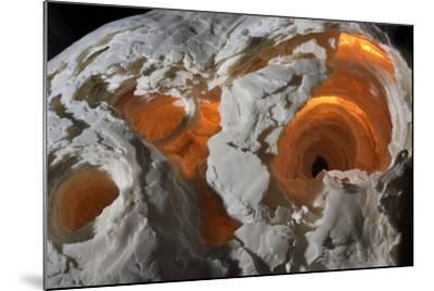 A stalagmite formation illuminated from within.-Joel Sartore-Mounted Photographic Print
