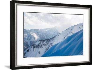 A Snowboarder Cuts a Turn into a Slope in the Backcountry Near Takayama-Max Lowe-Framed Photographic Print