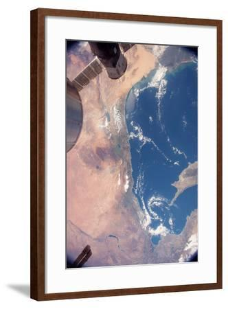 The Deep Blue of the Mediterranean Sea Contrasts with the Tan, Arid Land-Terry Virts-Framed Photographic Print