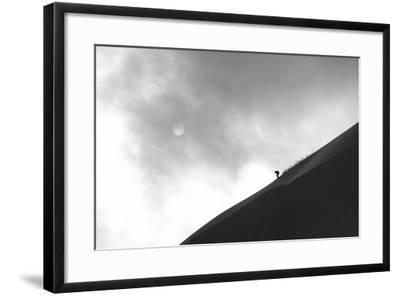 A Skier Runs Down the Skyline with the Sun Behind Clouds-Max Lowe-Framed Photographic Print