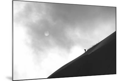 A Skier Runs Down the Skyline with the Sun Behind Clouds-Max Lowe-Mounted Photographic Print