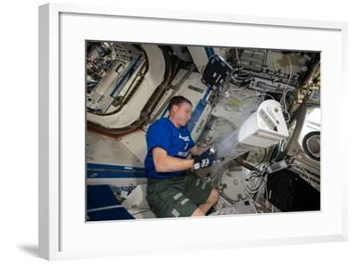 Astronaut Works with the Minus Eighty-Degree Laboratory Freezer for an Iss Experiment-Terry Virts-Framed Photographic Print