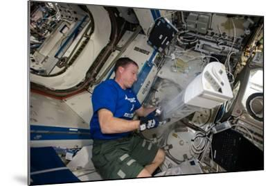 Astronaut Works with the Minus Eighty-Degree Laboratory Freezer for an Iss Experiment-Terry Virts-Mounted Photographic Print