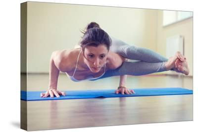 Beautiful Young Woman Yoga Workout in Gym-spass-Stretched Canvas Print