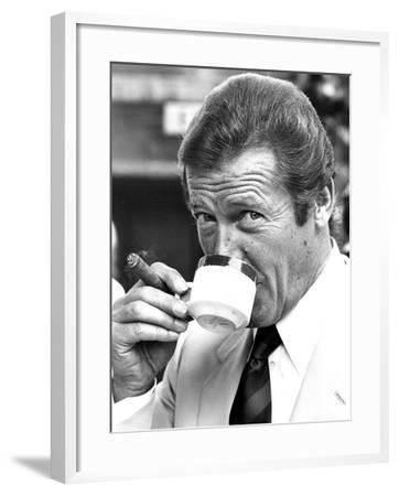 Roger Moore Drinking Coffee-Associated Newspapers-Framed Photo