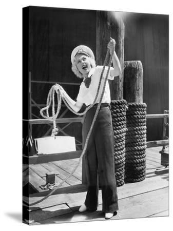 Ahoy, from a Young Woman in a Sailor's Outfit, Holding a Heavy Rope--Stretched Canvas Print