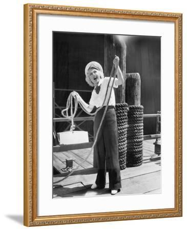 Ahoy, from a Young Woman in a Sailor's Outfit, Holding a Heavy Rope--Framed Photo
