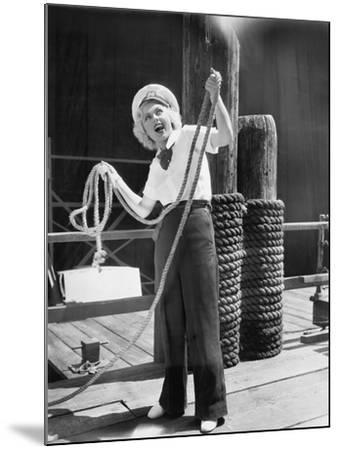 Ahoy, from a Young Woman in a Sailor's Outfit, Holding a Heavy Rope--Mounted Photo