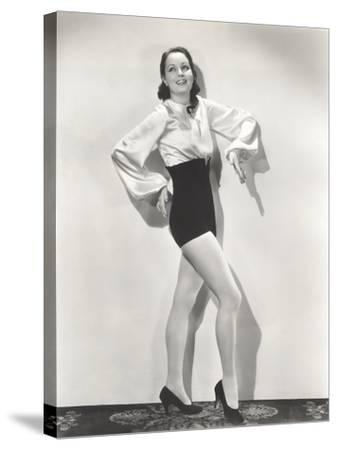 Dancer Posing in High-Waisted Shorts and Silk Blouse--Stretched Canvas Print