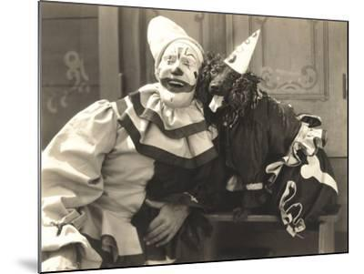Clown Posing with Dog Dressed in Clown Costume--Mounted Photo