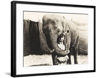Elephant Embracing Circus Performer--Framed Photo