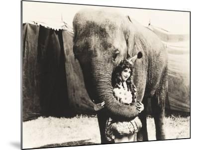 Elephant Embracing Circus Performer--Mounted Photo