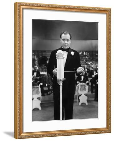 Conductor Standing in Front of His Orchestra with a Baton--Framed Photo