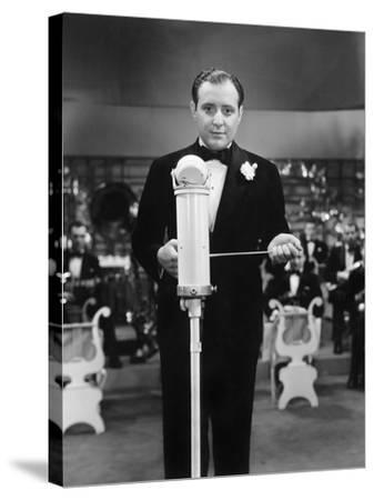 Conductor Standing in Front of His Orchestra with a Baton--Stretched Canvas Print