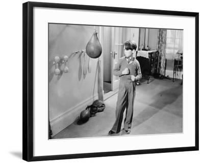 Boy with Punching Ball in the Living Room--Framed Photo