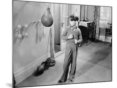 Boy with Punching Ball in the Living Room--Mounted Photo