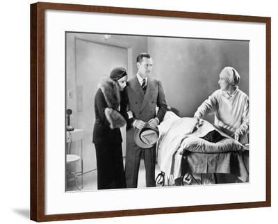 Couple Looking Upset at a Deceased Woman--Framed Photo