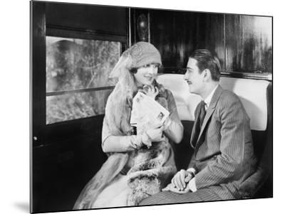 Couple in a Compartment of a Train Looking and Talking with Each Other--Mounted Photo