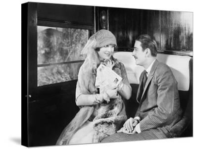 Couple in a Compartment of a Train Looking and Talking with Each Other--Stretched Canvas Print