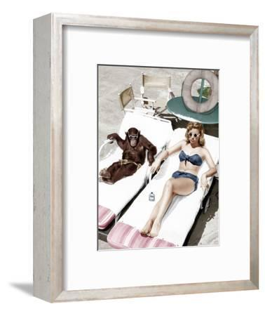Chimpanzee and a Woman Sunbathing--Framed Photo