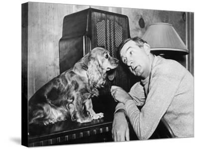 Man and Dog Listening to the Radio--Stretched Canvas Print