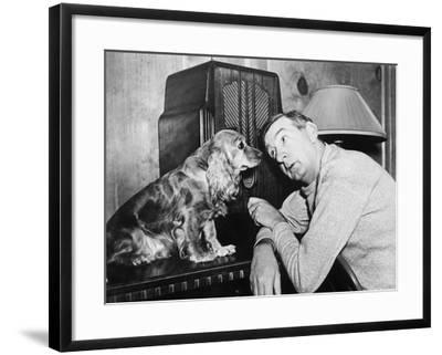 Man and Dog Listening to the Radio--Framed Photo