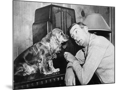 Man and Dog Listening to the Radio--Mounted Photo