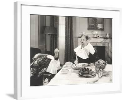 Man and His Pet Turkey Sitting Down to an Untraditonal Thanksgiving Dinner--Framed Photo