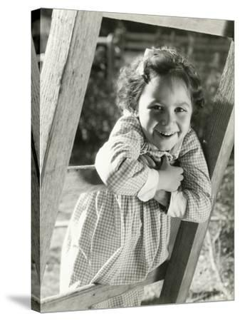 Little Girl Leaning on Ladder--Stretched Canvas Print