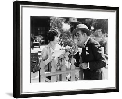 Man and Woman Talking over a Picket Fence--Framed Photo