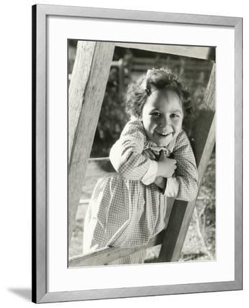 Little Girl Leaning on Ladder--Framed Photo