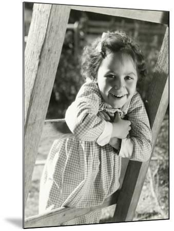 Little Girl Leaning on Ladder--Mounted Photo