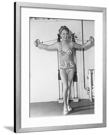 Keeping Her Girlish Figure--Framed Photo