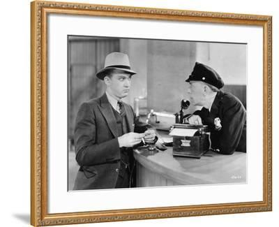 Man with Surprised Policeman--Framed Photo
