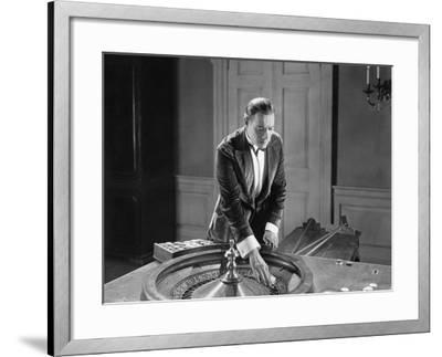 Man with Roulette Table--Framed Photo
