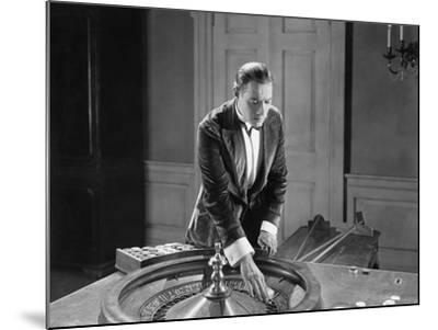 Man with Roulette Table--Mounted Photo