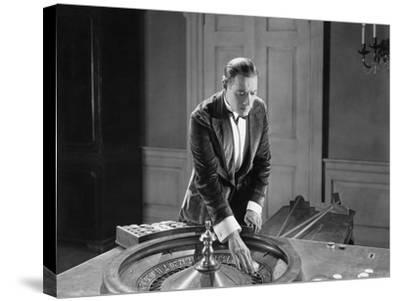 Man with Roulette Table--Stretched Canvas Print